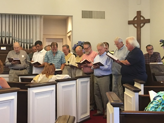 Men serenading on Mothers Day 2019